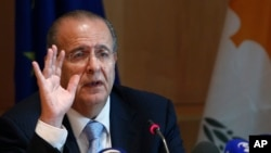 FILE - Cyprus Foreign Minister Ioannis Kasoulides speaks to the media at the foreign house in divided capital of Nicosia, Oct. 6, 2014.