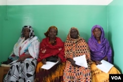 Women await their turns for free breast and cervical cancer screenings at the Philippe Maguilen Senghor health center in Yoff, Dakar, Senegal, April 22, 2017. (S. Christensen/VOA)