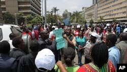 Kenyan teachers call on the government to increase hiring during a protest outside the Parliament building in downtown Nairobi. September 7, 2011.