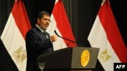 Egyptian President Mohammed Morsi addresses conference June 26, 2013 in Cairo (Egyptian Presidency photo)