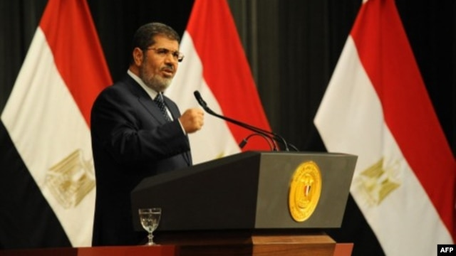 FILE - Egyptian President Mohamed Morsi addresses a conference June 26, 2013 in Cairo (Egyptian Presidency photo)