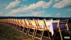 "A table set for an ""Outstanding in the Field"" meal"