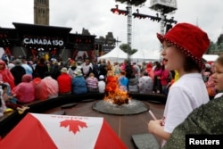 A young girl attends Canada Day celebrations on Parliament Hill in Ottawa, Ontario, July 1, 2017.