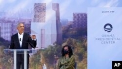Former President Barack Obama speaks as former first lady Michelle Obama listens during a groundbreaking ceremony for the Obama Presidential Center in Chicago, Sept. 28, 2021.