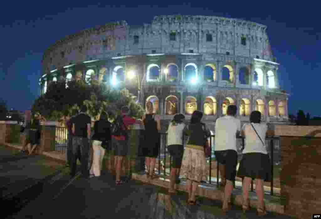 The Colosseum is lit up in Rome, Sunday, Sept. 11, 2011, to mark the 10th anniversary of the Sept. 11 attacks on the United States. A decade after 9/11, the day that changed so much for so many people, the world's leaders and citizens paused to reflect Su