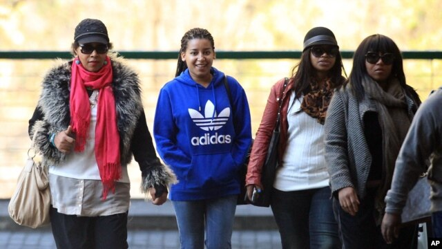 Daughter Zenani Dlamini-Mandela, left, with granddaughters Swati Dlamini, second right, and Zaziwe Dlamini-Manaway, right, and an unidentified family member arrive at the Mediclinic Heart Hospital , June 19, 2013.