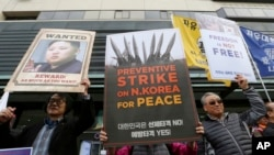 FILE - South Koreans protest against North Korea and Kim Jong Un during a rally near the U.S. Embassy in Seoul, South Korea, Nov. 6, 2017.