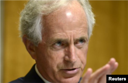 "FILE - Sen. Bob Corker, R-Tenn., says it's essential that ongoing FBI investigations are ""free of political interference."""