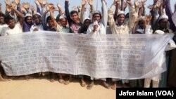 FILE - Some Rohingya refugees in Cox's Bazar, Bangladesh, are protesting against the community's repatriation to Myanmar, carrying a festoon on which their demands for repatriation are written.