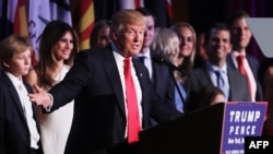 FILE - Republican President-elect Donald Trump delivers his acceptance speech during his election night event at the New York Hilton Midtown in New York City, Nov. 9, 2016.