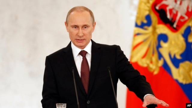 FILE - Russia's President Vladimir Putin addresses the Federation Council in Moscow's Kremlin, March 18, 2014.