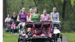 "Mothers and their babies in a park in Strongsville, Ohio, in a fitness class called ""Baby Boot Camp."" The classes are offered nationwide to help pregnant women and new mothers get fit."