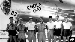 """This undated U.S. Air Force photograph shows the ground crew of the """"Enola Gay"""" airplane that bombed Hiroshima, Japan on August 6, 1945 with the """"Little Boy"""" nuclear bomb"""