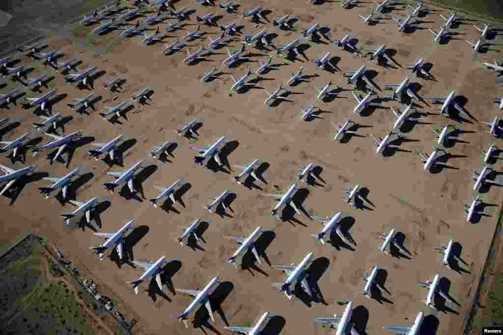 Old airplanes, including Boeing 747-400s, are stored in the desert in Victorville, California.