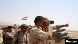 ក្រុមសកម្មប្រយុទ្ធ Peshmerga របស់ក្រុមយោធា Kurde យាមត្បាតនៅជាយក្រុង Gwer Town កាលពីថ្ងៃទី១៨ ខែសីហា ឆ្នាំ២០១៤។