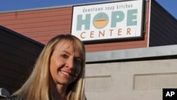 Denise Harle, an attorney with the conservative Christian law firm Alliance Defending Freedom, poses outside the Hope Center women's shelter in downtown, Anchorage, Alaska, Nov. 1, 2018.