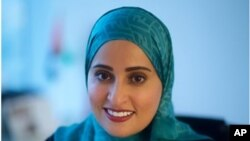 This undated image released by the Emirates News Agency, WAM, shows Ohood Al Roumi, the Minister of State for Happiness of the United Arab Emirates.