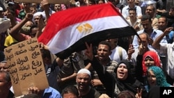 Egyptians shout during a protest in Tahrir Square, the focal point of uprising, June 3, 2011