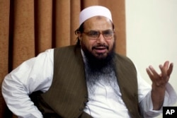 FILE - In this April 3, 2012, Hafiz Mohammed Saeed, chief of Jamaat-ud-Dawwa and founder of Lashkar-e-Taiba, talks with the Associated Press in Islamabad, Pakistan.