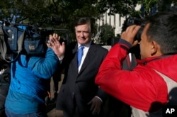 FILE - Paul Manafort makes his way through television cameras as he walks from U.S. District Court in Washington, Oct. 30, 2017.