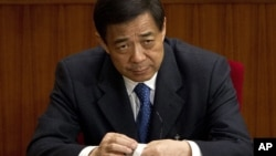 Then Chongqing party secretary Bo Xilai attends a plenary session of the National People's Congress at the Great Hall of the People in Beijing, March 11, 2012.