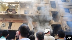 a damaged building that destroyed by a car bomb, at Jaramana neighborhood, in Damascus, Syria, Monday Oct. 29, 2012