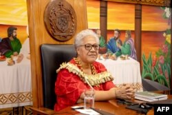 FILE - This picture released by the Samoa Observer on July 27, 2021, shows Samoa's new Prime Minister Fiame Naomi Mata'afa holding her cabinet's first meeting at the Government Building in Apia.