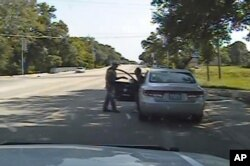 FILE - Frame from a dashcam video provided by the Texas Department of Public Safety shows a heated confrontation between trooper Brian Encinia with Sandra Bland after a minor traffic infraction, July 10, 2015.
