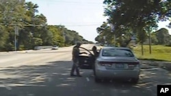 Frame from a dashcam video provided by the Texas Department of Public Safety shows a heated confrontation between trooper Brian Encinia with Sandra Bland after a minor traffic infraction, July 10, 2015.