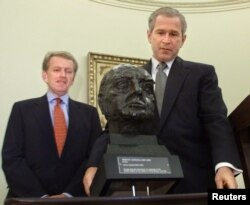 FILE - U.S. President George W. Bush inspects a bust of Winston Churchill presented by British Ambassador Christopher Meyer in the Oval Office of the White House in Washington, July 16, 2001. The bust was on loan from Tony Blair, then the prime minister of Britain.