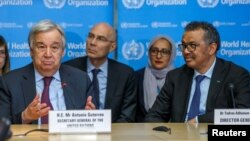 FILE - U.N. Secretary General, Antonio Guterres speaks while sitting next to WHO Director General Tedros Adhanom Ghebreyesus during an update on the situation regarding the COVID-19 at WHO headquarters in Geneva, Switzerland, February 24, 2020. (Salvatore
