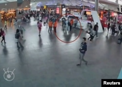 A still image from a CCTV footage appears to show a man purported to be Kim Jong Nam (circled in red) talking to airport staff, after being accosted by a woman in a white shirt, at Kuala Lumpur International Airport in Malaysia, Feb. 13, 2017. Kim later died of poisoning.