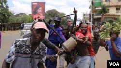 Youth took to the streets Monday demanding the resignation of Kenya's electoral commission officials, in Kisumu, Kenya, Oct. 16, 2017. Kenya's opposition has vowed to continue with the protests until its demands are met. (M. Yusuf/VOA)