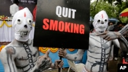 Activists dressed as skeletons participate in an awareness campaign on World No Tobacco Day in Kolkata, india, May 31, 2014.