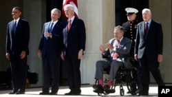 (L-R) President Barack Obama, former presidents George W. Bush, Bill Clinton, George H.W. Bush, and Jimmy Carter (R) at the dedication of the George W. Bush presidential library on the campus of Southern Methodist University in Dallas, April 25, 2013.