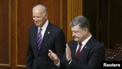 Ukraine's President Petro Poroshenko (R) greets U.S. Vice President Joe Biden at the parliament in Kyiv, Ukraine, Dec. 8, 2015.