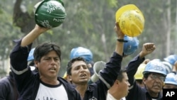 FILE - A group of miners demonstrate against Peru's government at the front of Labor Ministry building in Lima, May 3, 2007. A national strike to back a series of labor-related demands began days later led by Peru's National Federation of Mining, Metallur