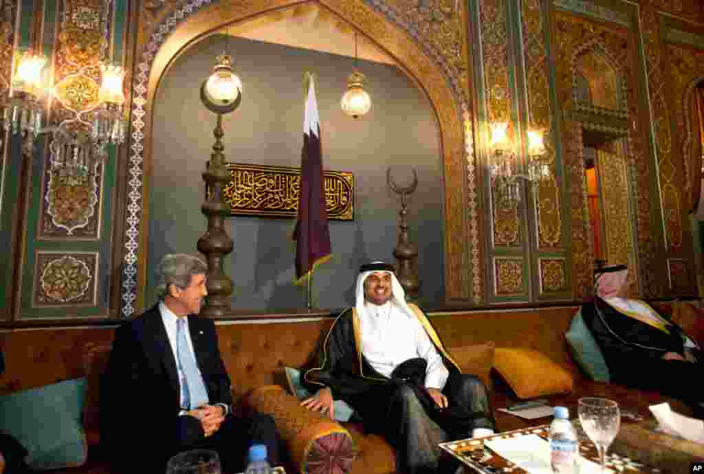 Secretary of State John Kerry, left, and Qatar crown prince, Sheik Tamim bin Hamad Al Thani, start their meeting at the Prince's Sea Palace residence in Doha, Qatar, March 5, 2013.