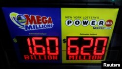 Signs display the jackpots for Tuesday's Mega Millions and Wednesday's Powerball lottery drawings in New York City, U.S., October 22, 2018. (REUTERS/Brendan McDermid )