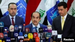 Riyadh al-Badran, the head of Iraq's Independent High Electoral Commission, speaks during a news conference on the results of the election in Baghdad, May 19, 2018.