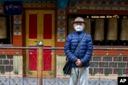 Kalsang Chokteng, an in exile Tibetan, poses for a photograph in Dharmsala, India, Tuesday, July 21, 2020. Kalsang says that people who do not want to wear masks are selfish and should think of the impact of their careless action on others.