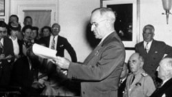President Harry Truman announcing the Japanese surrender during a news conference at the White House