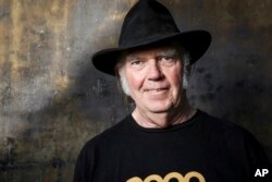 FILE - Neil Young poses for a portrait, May 18, 2016, in Calabasas, Calif. Young will perform at the Desert Trip music festival, kicking off Friday in Indio, California.