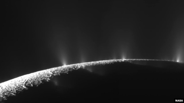 Numerous plumes are seen rising from long tiger-stripe canyons across Enceladus' craggy surface. Continued study of the ice plumes may yield further clues as to whether underground oceans, candidates for containing life, exist on this distant ice world.