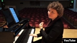FILE - Yael Weiss, seen in this undated photo from social media, has asked 32 composers to write piano pieces that reflect on a key event or figure from their respective countries. The concert is set for Jan. 24 in North Bethesda, Maryland. (Courtesy: YouTube screenshot)