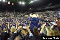 Students and their families celebrate graduation at Del Mar College in Corpus Christi, Texas.