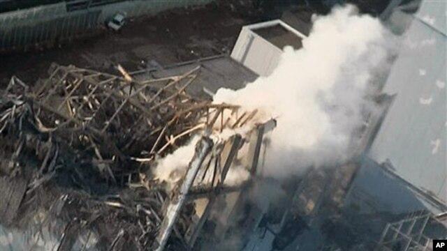Smoke billows from wrecked unit 3 at Japan's crippled Fukushima Daiichi nuclear power plant in Okumamachi, Fukushima Prefecture, March 16, 2011