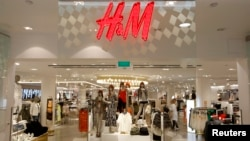 The company logo is placed at the flagship store of H&M, Hennes & Mauritz, the world's second-biggest fashion retailer in Sweden's capital Stockholm, file photo.