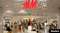 The company logo is placed at the flagship store of H&M, the world's second-biggest fashion retailer in Sweden's capital Stockholm, file photo.