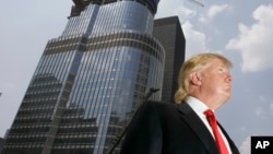 FILE - Donald Trump is profiled against his 92-story Trump International Hotel & Tower during a news conference on construction progress in Chicago.